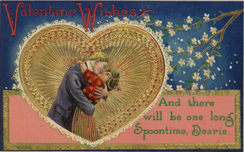 Vintage-valentine-card-kissing-couple-in-ornate-gold-heart